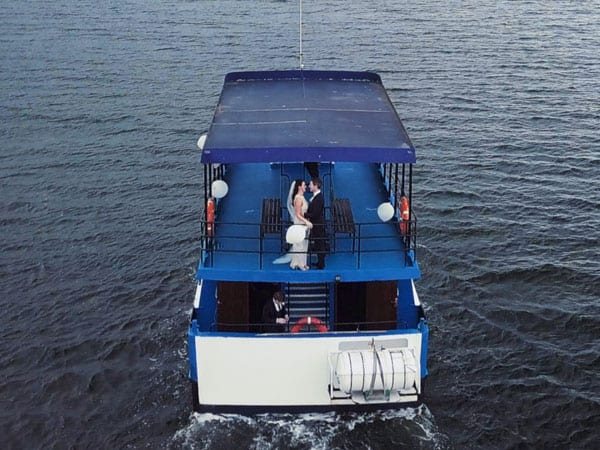 wedding couple filmed on a boat