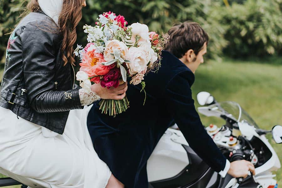 Bride and Groom on a motorbike